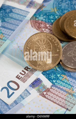 Berlin, Germany, Euro notes and former Greek Drachma coin - Stock Photo