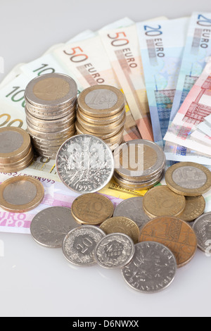 Berlin, Germany, Euro notes, Euromuenzen and former franc coins - Stock Photo