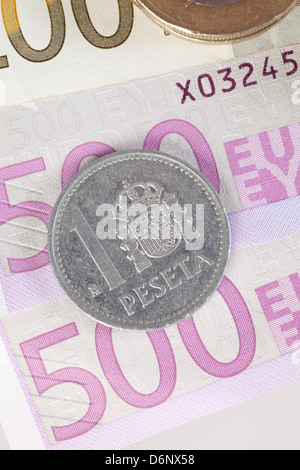 Berlin, Germany, Euro notes and former 1-peseta coin - Stock Photo