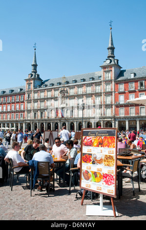 People sitting on terraces at the Main Square. Madrid, Spain. - Stock Photo