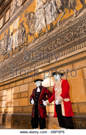 Mimes in historical costume with the 100 meter long Procession of Princes behind, Augustusstrasse, Dresden, Saxony, - Stock Photo