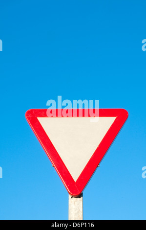 Keep way traffic sign against blue sky. - Stock Photo