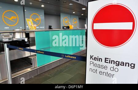 A 'No Entry' traffic sign is situated in front of closed check-in desks of the airline Lufthansa at the airport - Stock Photo