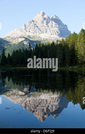 Reflections at sunset on Antorno Lake, Misurina, Tre Cime di Lavaredo, Belluno, Dolomites, Italy, Europe - Stock Photo