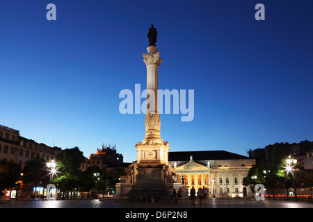 Statue of Portugal's King Dom Pedro IV, Dona Maria II national theatre at night, Rossio Square, Baixa district, - Stock Photo