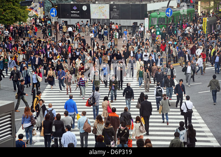 Japanese street scene showing crowds of people crossing the street on a pedestrian crossing in Shibuya, Tokyo, Japan - Stock Photo
