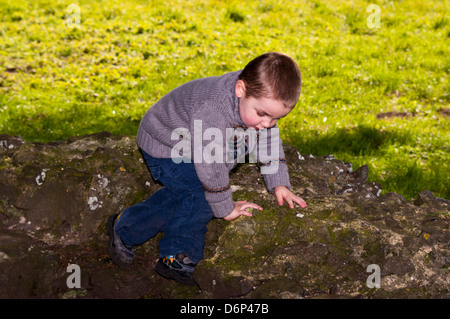 Toddler Playing Outside - Stock Photo