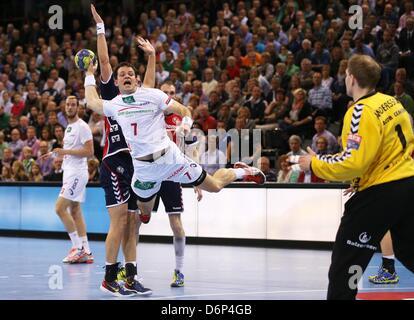 Hamburgs' Matthias Flohr throws at the goal of the Felnsburgs' keeper Mattias Andersson during the match SG Flensburg - Stock Photo