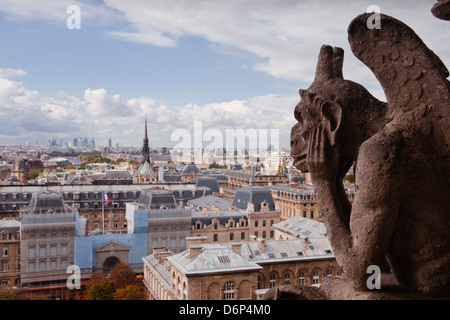 A gargoyle stares out from Notre Dame de Paris cathedral, Paris, France, Europe - Stock Photo