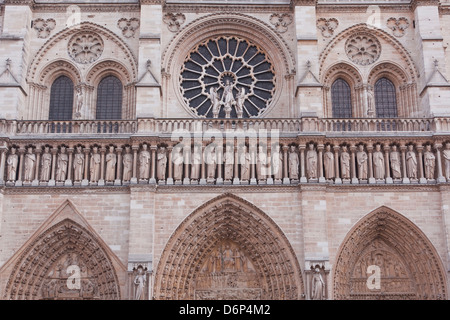 The facade of Notre Dame de Paris cathedral, Paris, France, Europe - Stock Photo