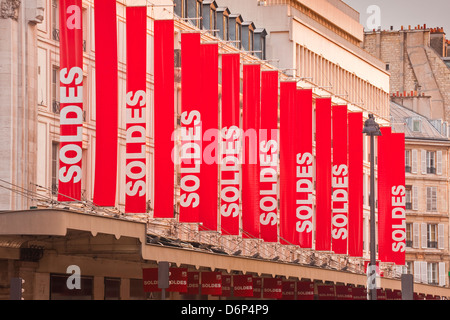 Sale sign banners in central Paris, France, Europe - Stock Photo