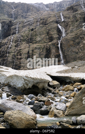 Small glacier and source of the Gave River at the Cirque de Gavarnie, Pyrenees National Park, Hautes-Pyrenees, France - Stock Photo
