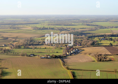 Aerial view of rolling rural landscape with small villages, winter wheat fields and pastureland, Suffolk, England, - Stock Photo