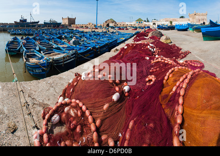 Fishing nets and blue fishing boats in Essaouira Port, formerly Mogador, Morocco, North Africa, Africa - Stock Photo