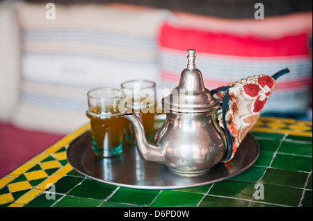 Moroccan mint tea pot at a cafe in Marrakech, Morocco, North Africa, Africa - Stock Photo