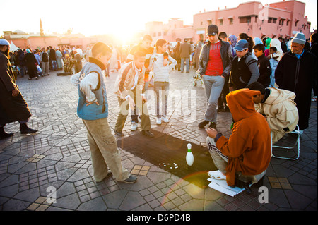 Moroccan people playing street games in Place Djemaa El Fna, the famous square in Marrakech, Morocco, North Africa, - Stock Photo