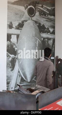 A picture of the Nazi-era shows the image of a A4 rocket on display at the Peenemuende Information Centre for History - Stock Photo