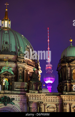 Close-up of the Berliner Dom (Cathedral) with the Television Tower in the background at night, Berlin, Germany, - Stock Photo