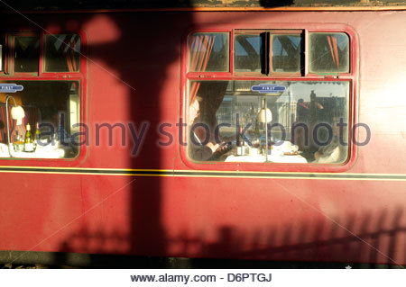 Passengers in a vintage first class railway carriage on a steam excursion special train service in north Wales, - Stock Photo