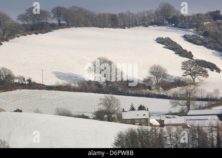 A view of snow covered hills in Dorset UK - Stock Photo
