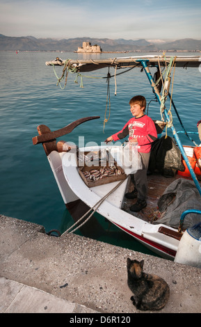 Selling fish in the harbour at Nafplio with the Bourtzi island and fort in the background, Argolid, Peloponnese, - Stock Photo