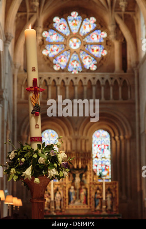 Candle in Christ Church College cathedral decorated for Maundy Thursday visit by Queen in 2013. Oxford, Oxfordshire, - Stock Photo