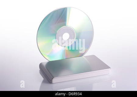 External hard disk and blank dvd on white background with reflection. Including clipping path. - Stock Photo