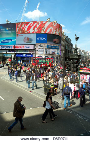Busy street scene at Piccadilly Circus, with pedestrians in abundance. London, UK, 2013. - Stock Photo