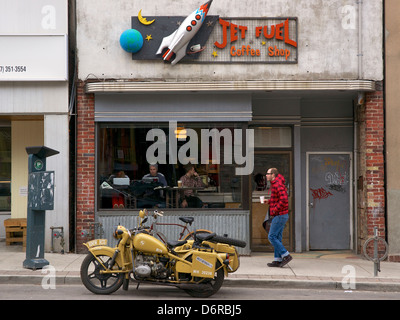 A restored World War 2 era BMW R75 parked in front of Jet Fuel coffee shop in Toronto, Ontario, Canada. - Stock Photo