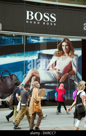 London, UK, passersby on Boss Store (Hugo Boss) in the shopping mall Westfield Startford City - Stock Photo