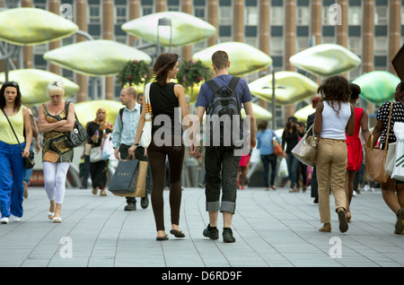 London, UK, passersby on a place in the Stratford district in the East End of London