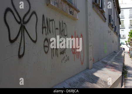 Graffiti on a wall in Athens, Greece - Stock Photo