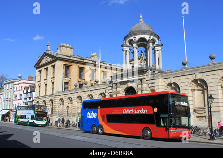Electric Hybrid double deck bus and Oxford Tube bus in High Street, Oxford outside The Queen's College. - Stock Photo