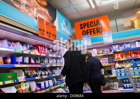 A couple man woman buying food in a branch of Lidl discount supermarket UK - Stock Photo
