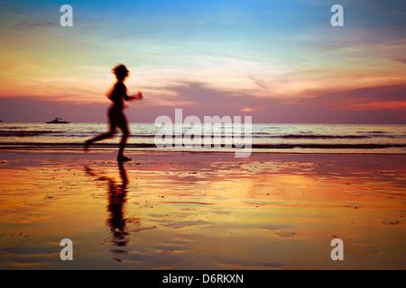 run to purpose, woman silhouette on the beach - Stock Photo