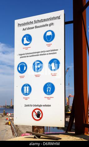 Emden, Germany, Schutzausruestung sign with instructions for personal / work site safety lock Nesserlander - Stock Photo