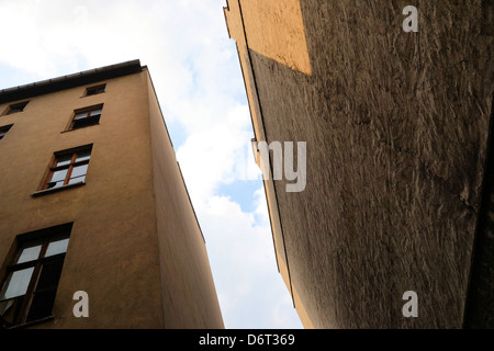 old abandoned house on a backyard - Stock Photo