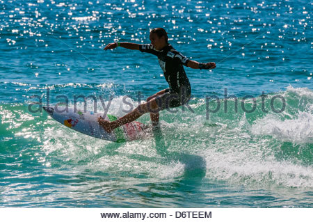 Female pro surfer competing in the finals of the Australian Open of Surfing, Manly Beach, Sydney, New South Wales, - Stock Photo