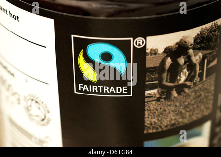 A jar of coffee showing the fairtrade logo - Stock Photo