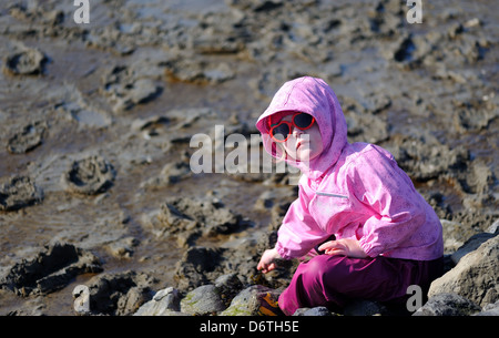 6 year old girl in the mud - Stock Photo