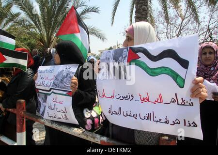 April 23, 2013 - Gaza City, Gaza Strip, Palestinian Territory - Palestinian women hold placards during a rally in - Stock Photo