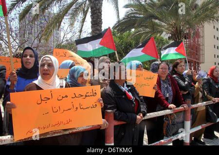April 23, 2013 - Gaza City, Gaza Strip, Palestinian Territory - Palestinians take part in a rally calling for ending - Stock Photo