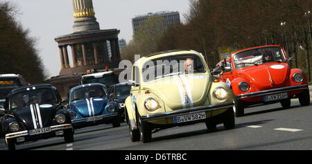 VWBugs from sightseeing company 'OldieKaefer Tour' drive past the Siegessaeule in Berlin,Germany, 23 April 2013. - Stock Photo