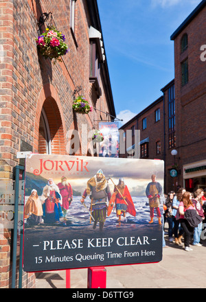 Decorated Queuing sign at the York Jorvik Viking Centre entrance Coppergate City centre North Yorkshire England - Stock Photo