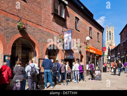 Tourists queuing at  the York Jorvik Viking Centre entrance Coppergate City centre North Yorkshire England UK GB - Stock Photo