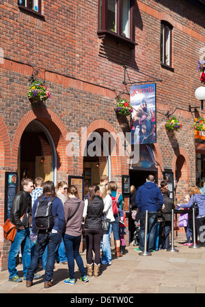 Tourists queuing at  the York Jorvik Viking Centre entrance Coppergate City centre North Yorkshire England UK GB - Stock Photo