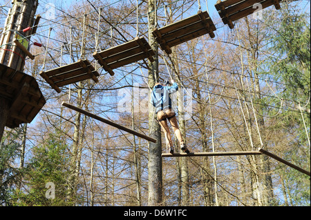 teenager on the GO Ape obstacle course at Dalby forest , england uk - Stock Photo