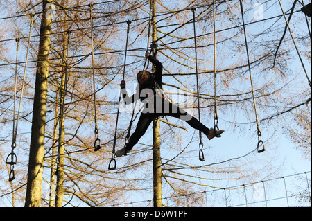 teenage girls doing the obstacle course at Dalby Forest, north yorkshire, uk - Stock Photo