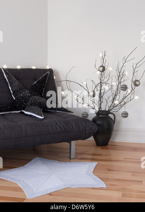 Cozy lights and winter decorations in the living room. - Stock Photo
