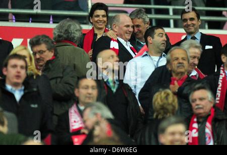 Munich's president Uli Hoeness (C) is hugged by Bayern Munich's basketball coach Svetislav Pesic on the stands prior - Stock Photo